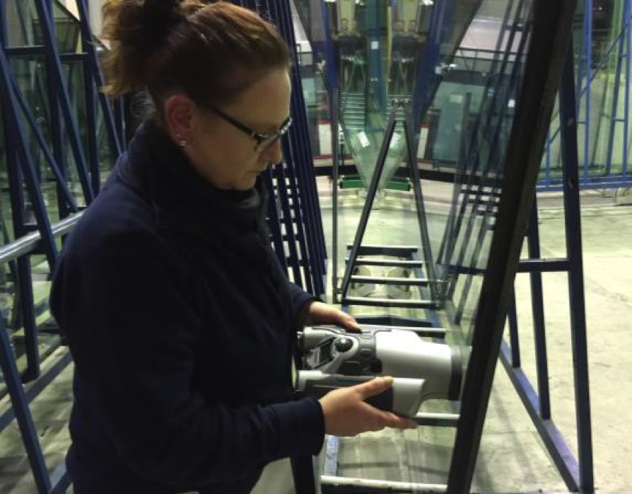 Interpane's employee conducting non-destructive insulating glass gas fill analysis with Sparklike Handheld device